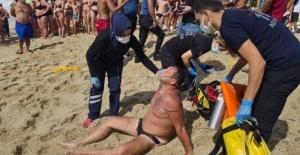 Boğulmak üzere olan turist cankurtaranın ipiyle hayata tutundu